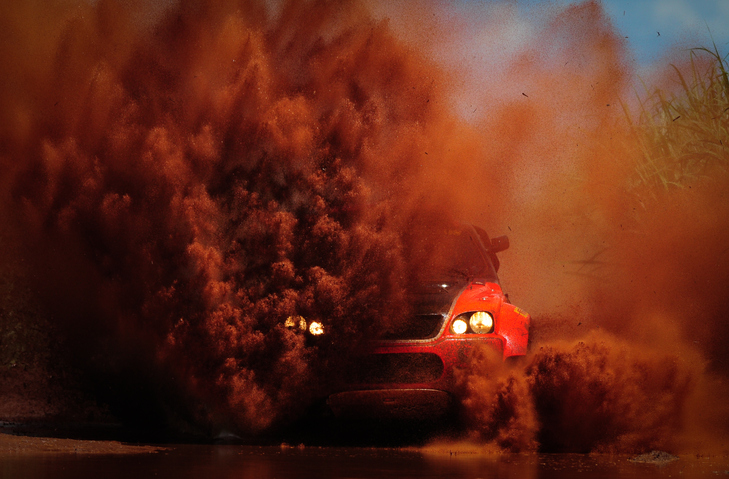 car kicking up dust